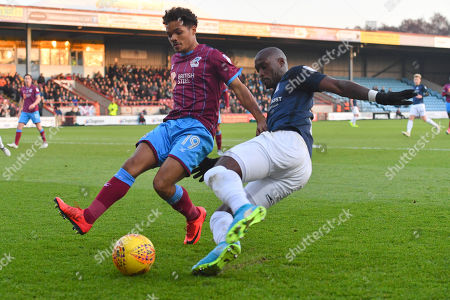 Scunthorpe United midfielder Duane Holmes (19) and Southend United forward Marc-Antoine Fortune (9) during the EFL Sky Bet League 1 match between Scunthorpe United and Southend United at Glanford Park, Scunthorpe