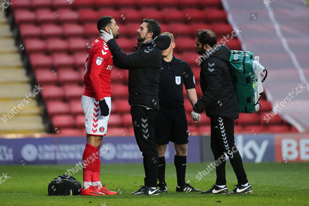 Charlton's Leon Best receives treatment to a head injury after a clash of heads during Charlton Athletic vs Blackpool, Sky Bet EFL League 1 Football at The Valley on 23rd December 2017