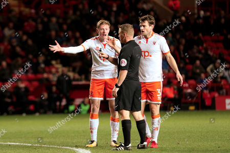 Sean Longstaff and Andy Taylor of Blackpool argue with a decision made by referee, John Busby during Charlton Athletic vs Blackpool, Sky Bet EFL League 1 Football at The Valley on 23rd December 2017