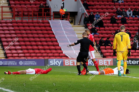 Referee John Busby stops play after a clash of heads between Charlton's Leon Best and Armand Gnanduillet of Blackpool during Charlton Athletic vs Blackpool, Sky Bet EFL League 1 Football at The Valley on 23rd December 2017