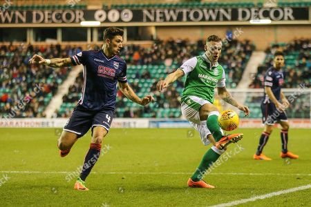 Christopher Routis (#4) of Ross County watches as Anthony Stokes (#28) of Hibernian controls the ball during the Ladbrokes Scottish Premiership match between Hibernian and Ross County at Easter Road, Edinburgh
