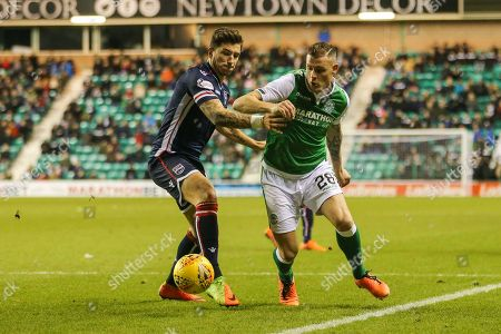 Anthony Stokes (#28) of Hibernian muscles his way into the penalty area marked by Christopher Routis (#4) of Ross County during the Ladbrokes Scottish Premiership match between Hibernian and Ross County at Easter Road, Edinburgh