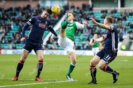 Stock Picture of Jason Naismith (#3) of Ross County heads the ball away from the outstretched leg of Anthony Stokes (#28) of Hibernian during the Ladbrokes Scottish Premiership match between Hibernian and Ross County at Easter Road, Edinburgh