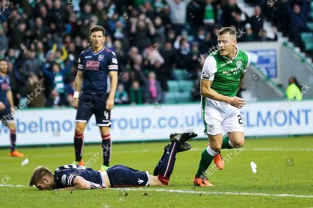 Anthony Stokes (#28) of Hibernian watches the ball cross the line as he scores Hibernian's first goal (1-1) during the Ladbrokes Scottish Premiership match between Hibernian and Ross County at Easter Road, Edinburgh