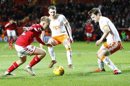 Charlton Athletics midfielder Ben Reeves taks on Blackpool's defender Andy Taylor during the EFL Sky Bet League 1 match between Charlton Athletic and Blackpool at The Valley, London