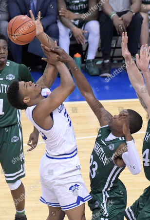 Desi Rodriguez, Rich Williams. Seton Hall forward Desi Rodriguez (20) is fouled by Manhattan guard Rich Williams (23) during the first half of an NCAA college basketball game, in Newark, N.J