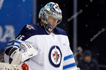 Winnipeg Jets goalie Steve Mason reacts against the New York Islanders in the second period of an NHL hockey game, in New York