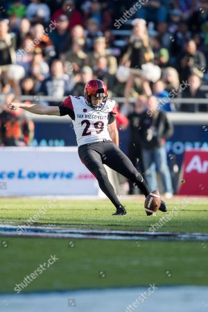 Stock Photo of San Diego State Aztecs place kicker John Baron II (29) kicks off during the Lockheed Martin Armed Forces Bowl between The San Diego State University Aztecs and the Army Black Knights at the Amon G. Carter Stadium in Fort Worth, TX