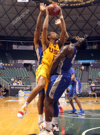 USC Trojans guard Jordan McLaughlin (11) charges Middle Tennessee Blue Raiders guard Giddy Potts (20) during game between USC Trojans and the Middle Tennessee Blue Raiders at the Hawaiian Airlines Diamond Head Classic at the Stan Sheriff Center on the campus of the University of Hawaii in Honolulu, Hawaii - Michael Sullivan/CSM