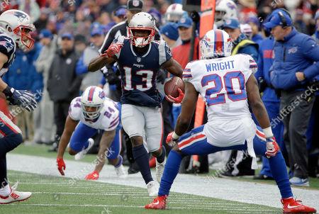 Phillip Dorsett, Leonard Johnson, Shareece Wright. New England Patriots wide receiver Phillip Dorsett (13) runs from Buffalo Bills defensive back Leonard Johnson (24) and cornerback Shareece Wright (20) during the first half of an NFL football game, in Foxborough, Mass