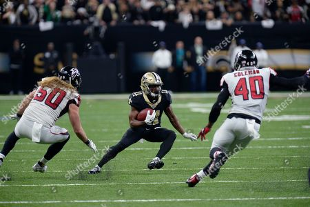 New Orleans Saints wide receiver Tommylee Lewis (11) carries against Atlanta Falcons defensive end Brooks Reed (50) and fullback Derrick Coleman (40) in the second half of an NFL football game in New Orleans