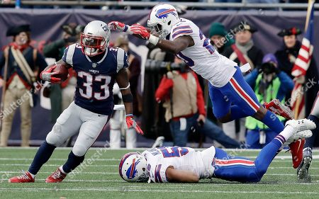 Shareece Wright, Dion Lewis. Buffalo Bills cornerback Shareece Wright, right, dives over linebacker Matt Milano (58) at New England Patriots running back Dion Lewis (33) during the first half of an NFL football game, in Foxborough, Mass