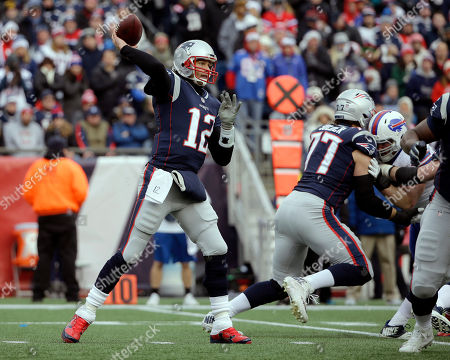 New England Patriots quarterback Tom Brady attempts a pass to Kenny Britt, which was intercepted by Buffalo Bills safety Jordan Poyer during the first half of an NFL football game, in Foxborough, Mass