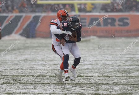 Chicago Bears wide receiver Josh Bellamy (15) is tackled by Cleveland Browns defensive back Justin Currie (39) in the first half of an NFL football game in Chicago