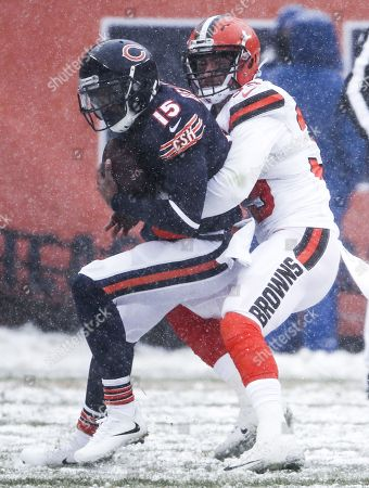 Cleveland Browns defensive back Justin Currie (R) tackles Chicago Bears wide receiver Josh Bellamy on a five yard pass play as snow falls in the first half of their NFL game at Soldier Field in Chicago, Illinois, USA, 24 December 2017.