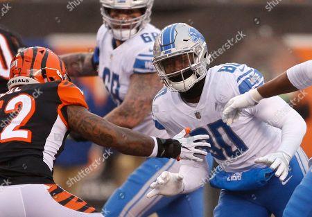 Michael Roberts, Brandon Bell. Detroit Lions tight end Michael Roberts (80) goes up against Cincinnati Bengals linebacker Brandon Bell (52) during the second half of an NFL football game, in Cincinnati