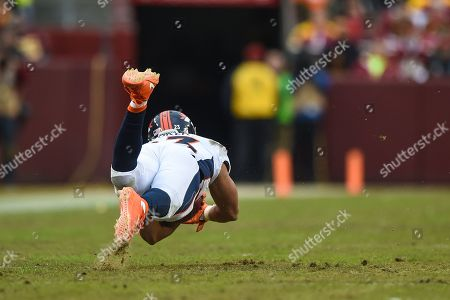 Denver Broncos running back Devontae Booker (23) trips after being tackled by Washington Redskins linebacker Pete Robertson (45) during the season ending home matchup between the Denver Broncos and the Washington Redskins at FedEx Field in Landover, MD