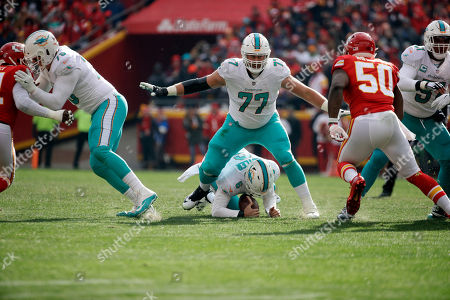 Jesse Davis, Jay Cutler, Justin Houston. Miami Dolphins tackle Jesse Davis (77) stands over quarterback Jay Cutler (6), who recovered his fumbled ball as Kansas City Chiefs linebacker Justin Houston (50) closes in, during the first half of an NFL football game in Kansas City, Mo