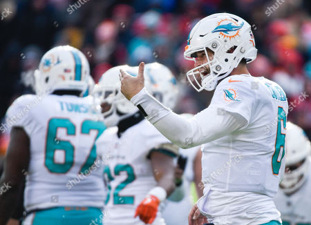 Miami Dolphins quarterback Jay Cutler (6) calls to the sidelines during the first half of an NFL football game in Kansas City, Mo