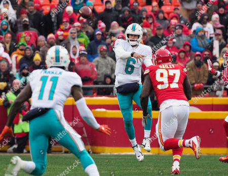 Jay Cutler, DeVante Parker. Miami Dolphins quarterback Jay Cutler (6) throws to Miami Dolphins wide receiver DeVante Parker (11) during the first half of an NFL football game in Kansas City, Mo