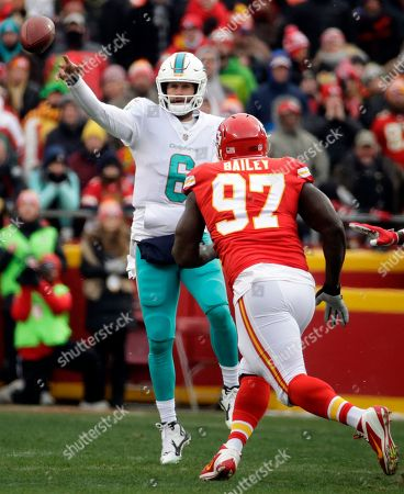 Jay Cutler, Allen Bailey. Miami Dolphins quarterback Jay Cutler (6) throws under pressure from Kansas City Chiefs defensive lineman Allen Bailey (97) during the first half of an NFL football game in Kansas City, Mo