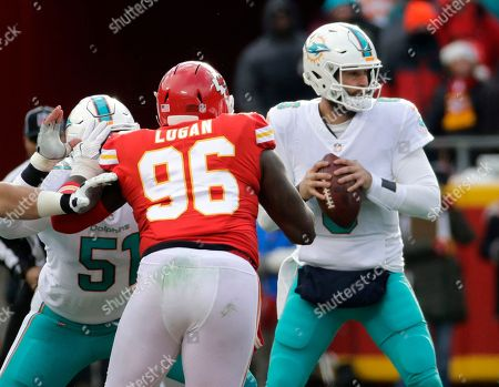 Bennie Logan, Jay Cutler, Mike Pouncey. Miami Dolphins quarterback Jay Cutler (6) looks for a receiver as center Mike Pouncey (51) blocks Kansas City Chiefs defensive lineman Bennie Logan (96) during the first half of an NFL football game in Kansas City, Mo