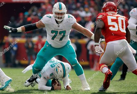Jesse Davis, Jay Cutler, Justin Houston. Miami Dolphins tackle Jesse Davis (77) stands over quarterback Jay Cutler (6), who recovered his fumble, as Kansas City Chiefs linebacker Justin Houston (50) closes in during the first half of an NFL football game in Kansas City, Mo