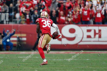 San Francisco 49ers cornerback Dontae Johnson (36) returns an interception for a touchdown against the Jacksonville Jaguars during the first half of an NFL football game in Santa Clara, Calif