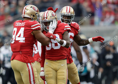 Solomon Thomas, Dontae Johnson, Adrian Colbert. San Francisco 49ers defensive end Solomon Thomas (94) celebrates with defensive back Adrian Colbert (38) and cornerback Dontae Johnson (36) during the first half of an NFL football game against the Jacksonville Jaguars in Santa Clara, Calif