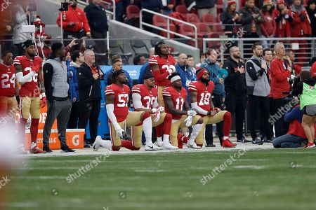 Eli Harold, Eric Reid, Marquise Goodwin, Louis Murphy. San Francisco 49ers outside linebacker Eli Harold, from bottom left, kneels with safety Eric Reid, wide receiver Marquise Goodwin and wide receiver Louis Murphy during the national anthem before an NFL football game against the Jacksonville Jaguars in Santa Clara, Calif