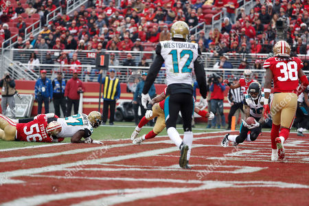 Jacksonville Jaguars wide receiver Jaelen Strong (10) scores a touchdown against the San Francisco 49ers during the first half of an NFL football game in Santa Clara, Calif