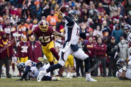 Denver Broncos quarterback Brock Osweiler (17) attempts a pass under pressure by Washington Redskins linebacker Pete Robertson (45) during the NFL game between the Denver Broncos and the Washington Redskins at FedExField in Landover, Maryland