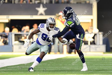 Dallas Cowboys wide receiver Dez Bryant (88) fumbles the ball after making a catch during an NFL football game between the Seattle Seahawks and the Dallas Cowboys at AT&T Stadium in Arlington, Texas