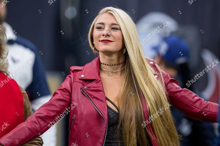 Country music singer Julia Cole is on hand to sing the national anthem prior to an NFL football game between the Houston Texans and the Pittsburgh Steelers at NRG Stadium in Houston, TX. The Steelers won the game 34 to 6