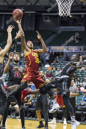 USC Trojans guard Elijah Stewart (30) scores a basket during the action between the University of Southern California Trojans and the New Mexico State Aggies at the Diamond Head Classic at Stan Sheriff Center in Honolulu, HI Glenn Yoza/ CSM