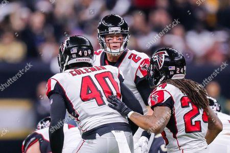 Atlanta Falcons quarterback Matt Ryan (2) tells the play to running back Devonta Freeman (24) and fullback Derrick Coleman (40) against New Orleans Saints at the Mercedes-Benz Superdome in New Orleans, LA. New Orleans Saints defeated Atlanta Falcons 23-13
