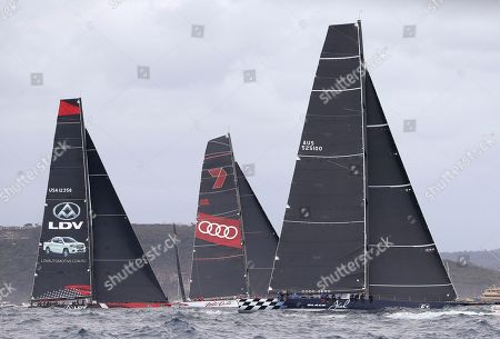 Stock Photo of Black Jack, Wild Oats XI, LDV Comanche. The supermaxis Black Jack, right, Wild Oats XI and LDV Comanche, left, pass the heads of Sydney Harbour during the start of the Sydney Hobart yacht race in Sydney, . The 630-nautical mile race has102 yachts starting in the race to the island state of Tasmania