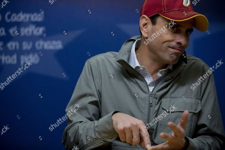 Opposition leader Henrique Capriles gives an interview at his office in Caracas, Venezuela. Capriles defended the opposition's outreach strategy to the poor as one more way to push forward his coalition's message at a time that traditional politics and fiery speeches have fallen short