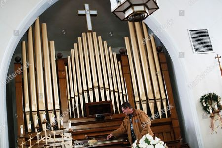 Tom Craig, a 20-year resident and member of the New Straitsville History Group, demonstrates the church organ, partially donated by steel tycoon Andrew Carnegie, at the United Methodist Church where his wife plays the instrument, in New Straitsville, Ohio. Communities across Appalachia are turning increasingly to the region's rich reserves in things other than coal, namely, history and rugged natural beauty, to frame a new tourist economy. Enjoying a drink, hike or overnight stay or in region infused with stories, sweat and strife is turning out to be a draw to aging baby boomers and millennials alike