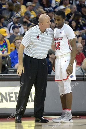Mike Maker, Austin Williams. Marist head coach Mike Maker, left, talks to guard Austin Williams (22) on the sideline during the first half of an NCAA college basketball game against West Virginia at the AdvoCare Invitational tournament, in Lake Buena Vista, Fla