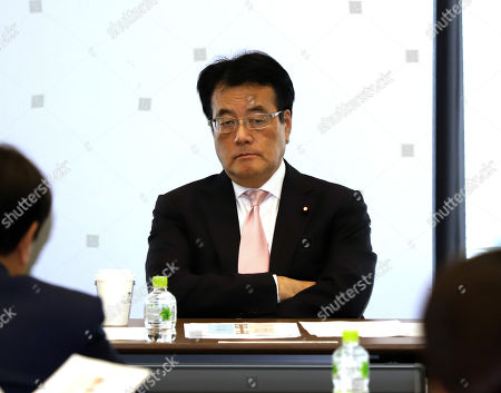 Stock Image of Katsuya Okada, former leader of Japan's opposition Democratic Party of Japan attends at the party's lawmakers and local organization representatives meeting in Tokyo