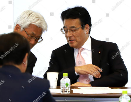 Stock Picture of Katsuya Okada, former leader of Japan's opposition Democratic Party Japan attends a speech at the party's lawmakers and local organization representatives meeting in Tokyo