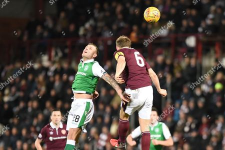 Mid air battle between Anthony Stokes and Christophe Berra during the Ladbrokes Scottish Premiership match between Heart of Midlothian and Hibernian at Tynecastle Stadium, Gorgie