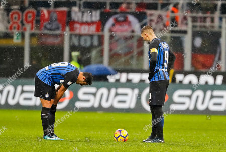 Inter Milan's captain Mauro Icardi, right, and teammate Martins Eder react after AC Milan's Patrick Cutrone, not shown, scored for his team during an Italian Cup quarter-final soccer match between Milan and Inter Milan at the San Siro stadium in Milan, Italy