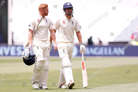 Jonny Bairstow and Alistair Cook walk off for lunch during day three of the Australia v England fourth test at the Melbourne Cricket Ground, Melbourne