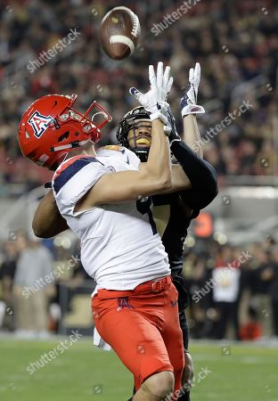 Stock Image of Tony Ellison, Navon Mosley. Arizona wide receiver Tony Ellison, left, makes a touchdown catch in front of Purdue safety Navon Mosley during the first half of the Foster Farms Bowl NCAA college football game, in Santa Clara, Calif