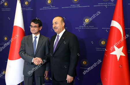 Taro Kano, Mevlut Cavusoglu. Japan's Foreign Minister Taro Kano, left, and Turkish Foreign Minister Mevlut Cavusoglu shake hands before a meeting in Ankara, Turkey