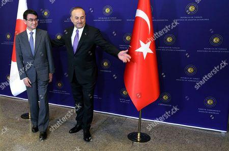 Taro Kano, Mevlut Cavusoglu. Turkish Foreign Minister Mevlut Cavusoglu, right, gestures to Japan's Foreign Minister Taro Kano before a meeting in Ankara, Turkey