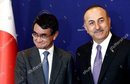 Stock Photo of Taro Kano, Mevlut Cavusoglu. Japan's Foreign Minister Taro Kano, left, and Turkish Foreign Minister Mevlut Cavusoglu shake hands before a meeting in Ankara, Turkey