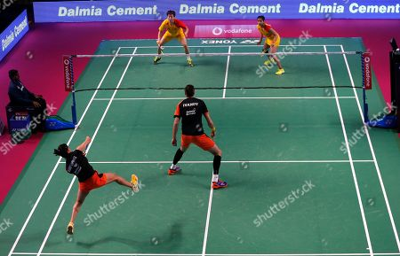 Korean badminton player Kim Sa Rang, top left, and Indian badminton player Sikki Reddy of Bengaluru Blasters, play against Indian badminton player Ashwini Ponnappa and Russian badminton player Ivanov Vladimir of Delhi Dashers during the Premier Badminton League mixed doubles match in New Delhi, India, . Bengaluru Blasters won the match 15-10, 12-15, 15-11